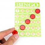 Hand putting last chip to be winner of bingo game — Stock Photo