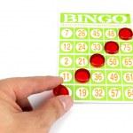 Hand putting last chip to be winner of bingo game — Stock Photo #52408591