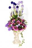 Decoration artificial plastic flower with vintage design vase — Stock Photo