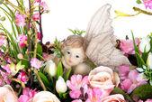 Decoration artificial plastic flower with vintage design vase cl — Stock Photo