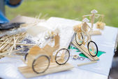 Vietnam crafts using soft wood to make a little bicycle — Stok fotoğraf