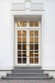 Vintage doors in front of building — Stock Photo