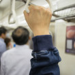 Hand of passengers hold on rail handle of transit system  — Stock Photo #63343791