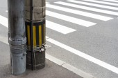 Electricity post in japan beside a crosswalk — Stock Photo