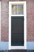 Vintage porte en face de la maison — Photo