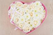 White roses and pearl and diamond held in the heart shape box — Stock Photo