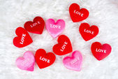 """Decorated gifts with a heart shapes and text """"love"""" — Stock Photo"""