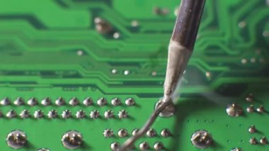 Repairing solder weld, fuse together by heating a lead to melt at the back of motherboard — Stock Video