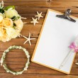 Planning paper with pen, rose headband, tiara, bouquet, starfish — Stock Photo #74932691