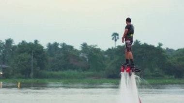 Man Playing a New water sport. Fly Board on chaopraya river — Stock Video
