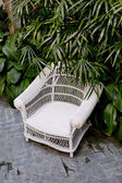Rattan chair with green trees at outdoor — Stock Photo