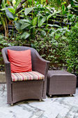 Rattan chair and rattan coffee table with green trees at outdoor — Stock Photo