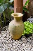 Clay jar in the garden — Stock Photo