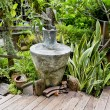 Antique style garden vase in garden — Stock Photo #65020095