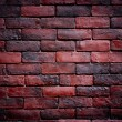 Weathered texture of stained old dark brown and red brick wall b — Stock Photo #65021495