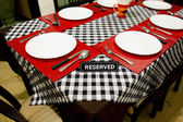 Reserved sign on a table in restaurant — Stock Photo