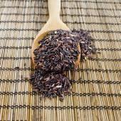 Thai black jasmine rice (Rice berry) in wooden spoon — Stock Photo