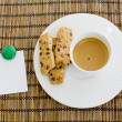 A cup of white coffee and chocolate chip cookies with notepad an — Stock Photo #65223755