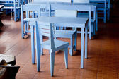 Classic blue chairs and tables — Стоковое фото
