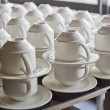 Many rows of pure white cup and saucer — Stock Photo #65232039