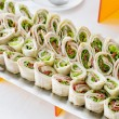 Plate of many mini bite size sandwich appetizers — Stock Photo #65335677