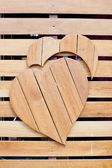 Wooden with heart shape on grunge wooden — Stock Photo