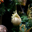 Stripy christmas ball, cristmas tree in the background — Stock Photo #66465187