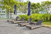 Wooden Pool beds and umbrella with daylight — Stock Photo