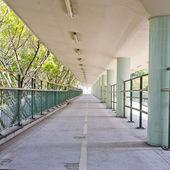 Walkway with a metal handrail. — Стоковое фото