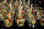 Finger Food in small glass with stick — Stock Photo