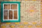 Old window in a brick wall — Stock Photo