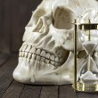 Creepy skull with sand clock — Stock Photo #52326267