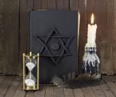 Halloween still life with black magic book — Zdjęcie stockowe