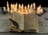 Open grimoire book with candles — Foto Stock