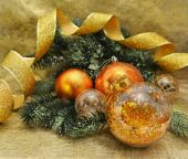 Baubles with green conifer branch — Stock Photo
