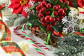 Christmas decorations and Holly berries — Stock Photo