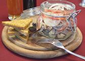 Pickled salmon in glass jar — Stock Photo