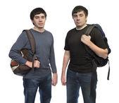 Irmãos gêmeos com mochilas — Fotografia Stock