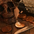 Pirate Vintage coins and skull — Stock Photo #65480493