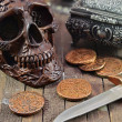 Pirate Vintage coins  and skull — Stock Photo #65480521