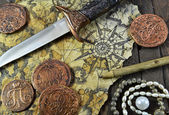 Pirate still life with dagger — Stock Photo