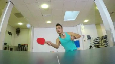 Wide angle view of an Asian man playing table tennis and winning — Stock Video