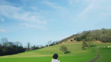 Girl running along a path — Stock Video