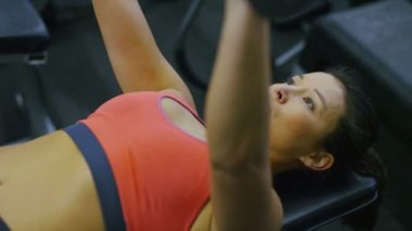 Woman in the gym with dumbbell — Stock Video