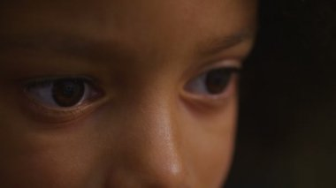 Eyes of a young child as she is engrossed in something on a screen — Stock Video