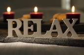 Text of the words relax with burning candles — Стоковое фото