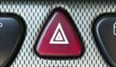 Car hazard light on a dashboard — Stock Photo