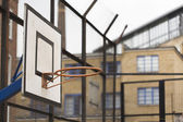 Basketball hoop and backboard within a housing estate — Stock Photo