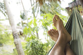 Male feet close up in a hammock — Stock Photo