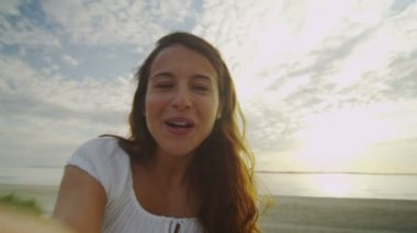 Beautiful woman on ocean beach having a video call in first person — Stock Video